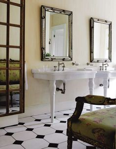 floral settee. pedestal sink. graphic floor. via Inspiring Interiors