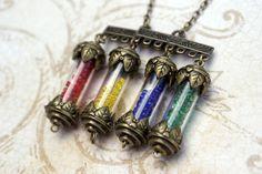 Harry Potter Hogwarts House Points Necklace, Gryffindor Hufflepuff Ravenclaw Slytherin. $40.00, via Etsy.