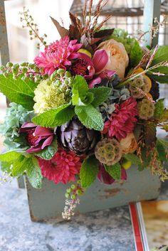 Vibrant table arrangement from Pat's Floral Designs