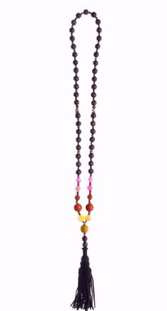 Brown suede tassel accents rainbow colored beads. Pair Ibiza with a tee and jeans and you'll think you've been transported to summer in Spain.
