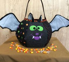Spooky Bat Trick or Treat Bag, Creepy Cute Halloween Centerpiece, Black, Orange & Green Quilted Loot Bag, Halloween Party Decor, Fully Lined by MakeMinePatchwork on Etsy https://www.etsy.com/listing/539252112/spooky-bat-trick-or-treat-bag-creepy