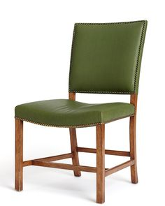 """""""Beautifully proportioned and so comfortable—this is a chair for a three-hour dinner party,"""" says Eisner. """"I could see this being handed down from generation to generation."""" Greenhill admires the hand- some nailheads and envisions the wood-and-leather piece (available to the trade) in a grand country house. Custom options are offered. 21"""" w. x 25"""" d. x 38"""" h.; $3,900; rosetarlow.com   - ELLEDecor.com"""