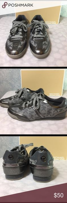 Michael Kors MK Trainers Michael Kors Trainer in gunmetal has MK signature jacquard fabric as main part of shoe body. Trimmed with gorgeous pewter metallic leather in all the right places. A perfect go-to weekend shoe or go comfy at the office--this shoe will fit in with biz casual too! Good used condition. Very slight scuffs that camera can't pick up. This shoe has been barely worn! Comes with original box. MICHAEL Michael Kors Shoes Sneakers