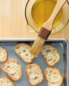 Crostini is just a fancy name for baguette slices that have been brushed with oil, sprinkled with salt and pepper, and baked until golden brown. Their salty crunch makes it hard not to munch on them plain, but resist temptation. Crostini makes for an endless variety of near-instant hors d'oeuvres. Just spoon on your pick of toppings and watch the crostini disappear!