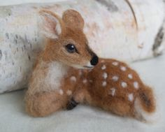 Needle Felted Deer Fawn, Curled Up, Laying Down by ClaudiaMarieFelt on Etsy https://www.etsy.com/ca/listing/162573320/needle-felted-deer-fawn-curled-up-laying