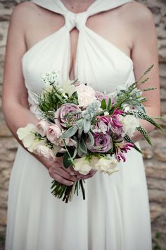 Natural hand-tied bouquet in silver and dusky pink. Photo by Marianne Taylor