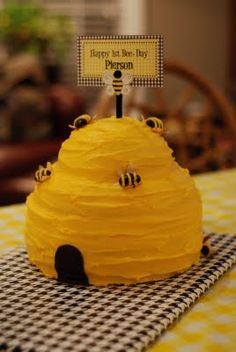 Pierson's 1st Bee Day Party hive cake with chocolate covered almond bees