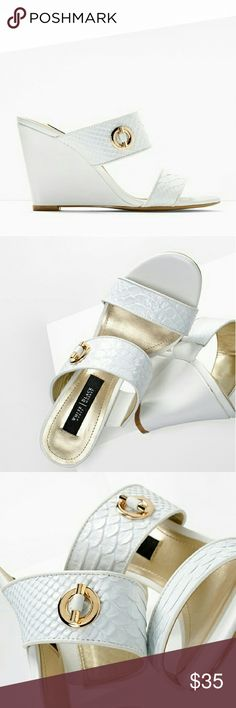 White Wedged Sandals Description Made with an exotic textured finish, these two-piece slide wedges are the summer shoes of the season?endlessly versatile from day to night. Slide wedge sandals Breathable lining; memory foam footbed Genuine leather and manmade materials; synthetic sole Approx. 3.5? wedge Imported. New and never worn! Shoes Wedges