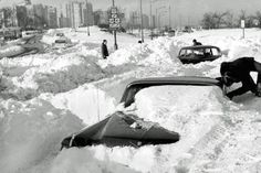 Chicago snowstorms through the years: A 1964 Cadillac being dug out of the snow near Lake Shore Drive and Foster on Jan. 27, 1967.
