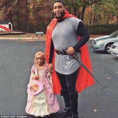 Knight in shining armor: Leah dressed up as Princess Rapunzel for Halloween this year, and was escorted for some trick-or-treating by her dad in a Prince Charming costume