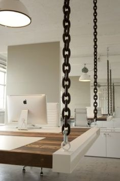 Suspended Desks- chain link, painted steel, and raw timber.