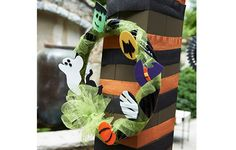 Make this quick and easy Halloween wreath using fabric and Phoomph