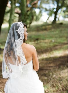 spanish style veil that is one circle of material. Called a Mantilla. what a great nod to hubby's spanish heritage.