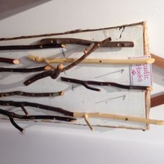 hooks made from twigs - look for these at my next craft fair.