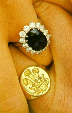 Charles wearing the Prince of Wales signet ring and Diana wearing her sapphire and diamond engagement ring