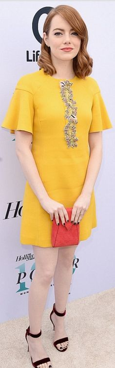 Emma Stone in Purse – Tyler Ellis  Jewelry – Jennifer Meyer and EF Collection  Dress – Giambattista Valli  Shoes – Gianvito Rossi