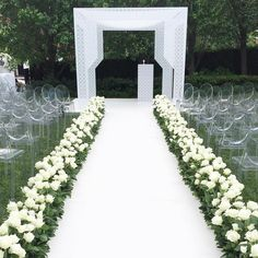"#CeremonyGoals! This sleek & graphic Chuppah with laser cut details is perfect for the trend-setting, modern couple. Also, the clear ""ghost"" chairs, chic white aisle & hedge of roses add to the minimalist look that is so very on point! Event Styling: @thedesigndepotinstagram"