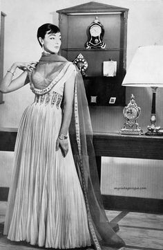 Ivy Nicholson wearing a gown byGattinoni for Moda Italiana, Spring/Summer, 1956.