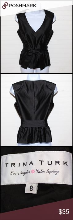 Beautiful Trina Turk black sleeveless. Very classy Very dressy, very classy black sleeveless blouse. Dress up a pair of skinny jeans and heels or a pretty pencil skirt. Trina Turk Tops Blouses