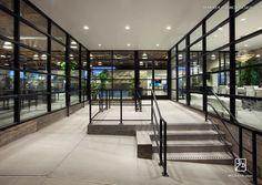 Black framed windows, open .com office, entry, reception. Maraya Interior Design