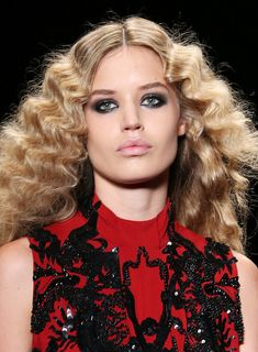 This beautiful 70's inspired hair was created by crimping at Just Cavalli
