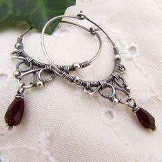 Handmade Wire Wrapped Earrings Filigree Sterling Silver Hoop Earrings Red Czech Glass. $52.00, via Etsy.