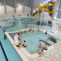 Elevation Place | 5 Family Hot Spots in Canmore - With 77,000 square feet of indoor attractions, Elevation Place is the go-to family fun zone in Canmore. Tricked out with a lazy river, waterslide and a 25 person hot tub, the pool area is flooded with natural light that streams in from the floor-to-ceiling windows. However, the big draw here is their climbing wall, or rather, climbing gym.