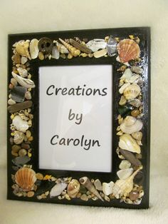 5x7 wall mounting photo frame.  #shell decore #shell crafts #picture #drift wood #beach  frame.  Creations by Carolyn on fb