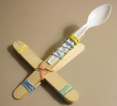 Mini Marshmallow Catapult with popsicle sticks, rubber bands, and plastic spoon - that's all!