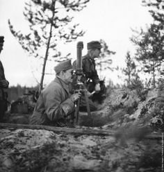 Carl Gustaf Emil Mannerheim (1867–1951), Commander-in-Chief of Finland's Defence Forces, watches operations in the Leningrad sector during World War II, circa 1941. (Photo by Three Lions/Hulton Archive/Getty Images)