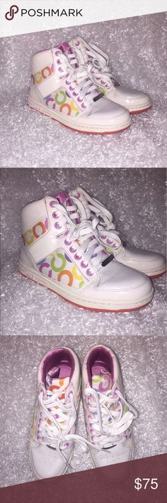 Gently Worn Coach Sneakers This is a gently worn pair of Coach sneakers! The only signs of wear on them are on the bottoms. They are sparkling white with pastel C's on the sides. Coach Shoes Sneakers