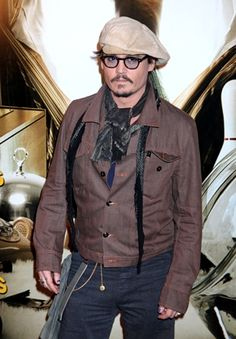 Johnny Depp arrives at a photo call for the French premiere of the film 'The Rum Diary' in Paris.