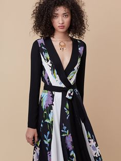 An effortless work to cocktails solution, this fluid wrap style shines in a soft floral print.
