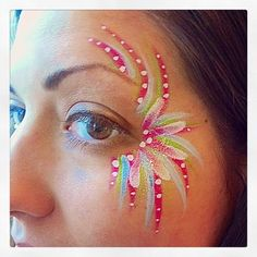 Face painting by Glitter Goose! Fireworks colorful burst fancy mardi gras eye design paint ideas