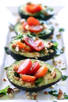 Cherry tomatoes, basil and almonds in avocado with a splash of oil and vinegar.