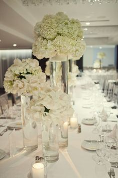 white modern reception wedding flowers, wedding decor, wedding flower centerpiece, wedding flower arrangement, add pic source on comment and we will update it. www.myfloweraffair.com can create this beautiful wedding flower look.