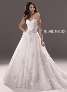 I love the subtlety of the falling flowers Large View of the Effie Bridal Gown