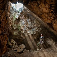 """@RobertClarkphoto #MarinaEliott gazes up to the top of #RisingStarCave in the remote site in the #CradleOfHumanKind hear #Johannesburg #SouthAfrica.  The cave has yielded hundreds of fossil bones that represetsent a new species of #human ancestor called #HomoNaledi. #LeeBerger a #Paleoanthropologist from #WitsUniversity in South Africa who lead the team says """"We found a most remarkable creature."""" For more pictures from the cave and what was found please look at my feed @RobertClarkphoto  The…"""
