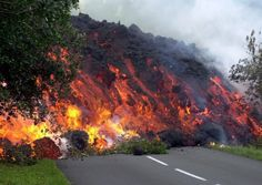 Volcanoes - Anything in the path of a lava flow will be destroyed. Trees, homes and even roads, as seen here, dont stand a chance. Next, see what this road probably looked like after the lava flow came through. Natural Phenomena, Natural Disasters, Volcano Pictures, Volcan Eruption, Wild Weather, Lava Flow, Tornados, Tsunami, Belleza Natural