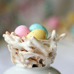 Easter / Springtime Bird Nests ~ with chow mein noodles, marshmallows & speckeled choc. eggs; shaped in a muffin tin.