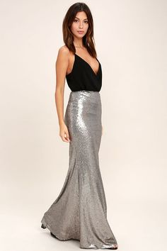 The Effervescent Evening Matte Gunmetal Sequin Maxi Skirt is sure to show off your bubbly personality! Woven poly is decorated with a sea of matte sequins that bedazzle from the high, fitted waist, down to the flaring maxi hem. Hidden zipper& at back. Faviana Dresses, Silver Skirt, Christmas Party Outfits, Frack, Dressy Attire, Sequin Maxi, Maxi Skirt Black, Womens Maxi Skirts, Casual Skirts