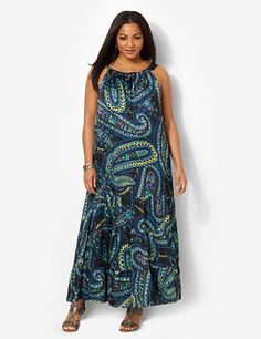 Comes in an intriguing paisley print in complementary colors. Silky style has a high neckline with a tunnel design. Horizontal seams at the hem fall to soft gathers below to create a tiered look. Complete with a keyhole slit on the upper back with a button closure. Fully lined. Catherines plus size dresses are expertly designed to flatter your figure. catherines.com