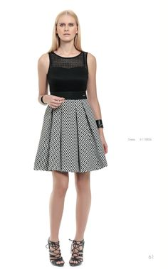 Put a delicate spin on your night choosing a mini black dotted dress and a pair of heels for a statement outfit!