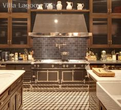 Los Angeles home with french cement tile kitchen floor in cubes pattern
