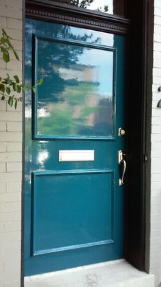 High Gloss Lacquer front door. Teal Green Front Door with black trim and tan painted brick exterior. Fine Paints of Europe Hollandlac Brilliant. front door. teal green.