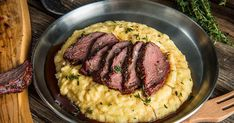 Smoked Elk Loin with Creamy Polenta. Rosemary is the perfect complement for this delicious game meat. Freshly harvested elk loin is rubbed down with rosemary, garlic, a little salt & pepper, roasted over smoky mesquite hardwood and served on top of a hear Venison Tenderloin, Venison Steak, Elk Recipes, Traeger Recipes, Game Recipes, Smoker Recipes, Dinner Recipes, Salsa Verde Recipe, Rpg