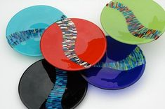 Bullseye glass with pattern bars over clear glass with opaque colorful inlays