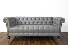 """Vintage Reupholstered Chesterfield Sofa with Brass Nailheads. Circa 1920's. Material: Grey LinenSize: 24""""D x 25""""H x 74"""" LCustom orders are welcomed! Email us at interiors@roomtorunway.com Delivery for Chicago clients.Separate shipping invoice will be sent after purchase for clients outside of the Chicagoland area. Available for PayPal Financing."""