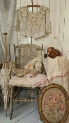 lovely vignette with old lace, chippy chair, and needlework
