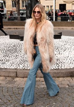 Poppy Delevingne steps back in time in retro bell-bottomed flares and an oversized shaggy fur coat at Miu Miu PFW show  Read more: http://www.dailymail.co.uk/tvshowbiz/article-2989887/That-70s-girl-Poppy-Delevingne-steps-time-wearing-bell-bottomed-flares-shaggy-fur-effect-coat-Miu-Miu-fashion-Paris.html#ixzz3U6LOhm1Q Follow us: @MailOnline on Twitter | DailyMail on Facebook